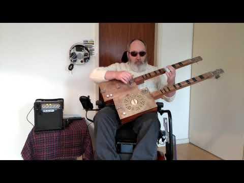 2 x three string double neck cigar box guitar.