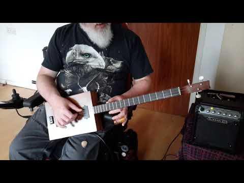 Three string, mango wood body, cigar box style electric guitar.