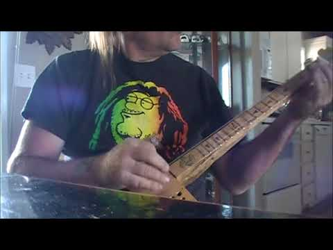 Roll & Tumble Blues Bottleneck Slide Cover on Cigar Box Guitar and Tenor Ukulele