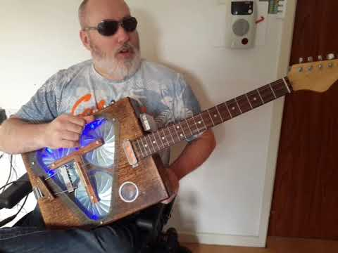 The Big Reveal! Homemade Tricone Resonator Guitar with goldfoil pickup.