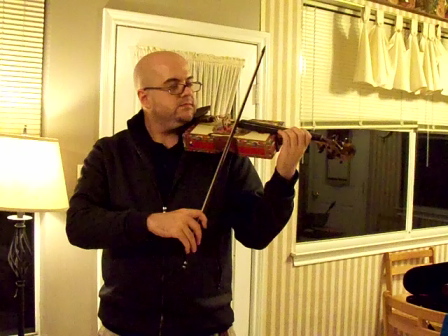 Fiddle being made into a Violin