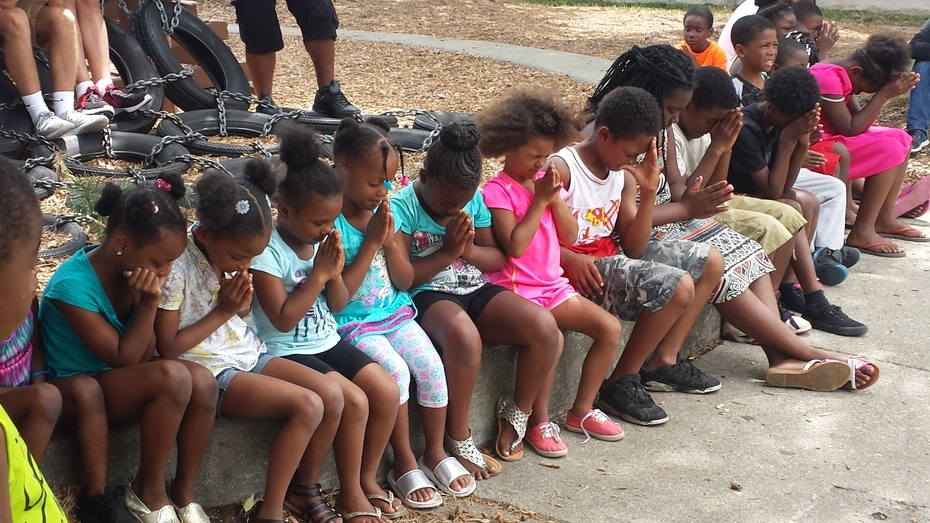 Children learning to pray