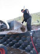 bobcat delivering soil
