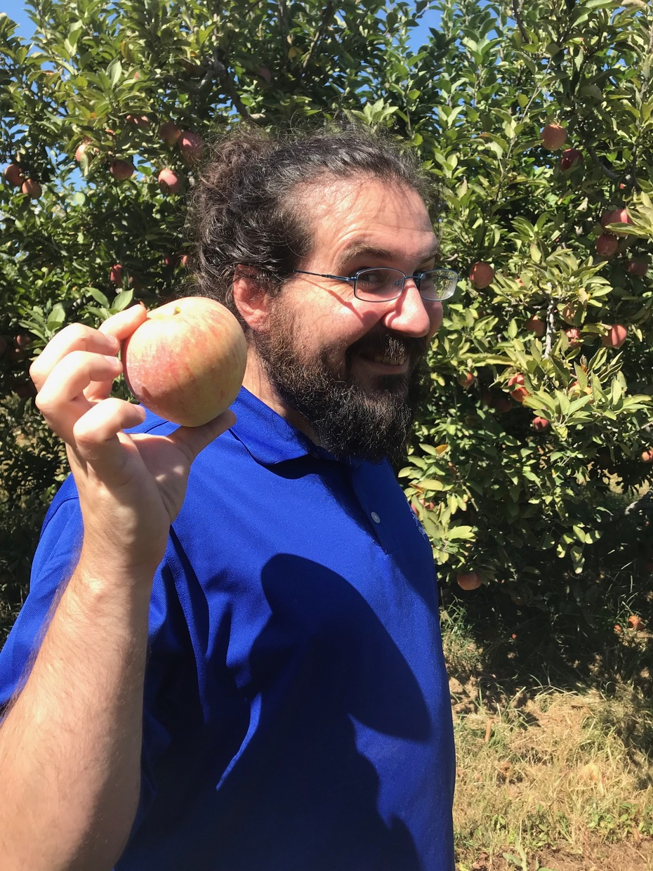 Jason showing off an apple