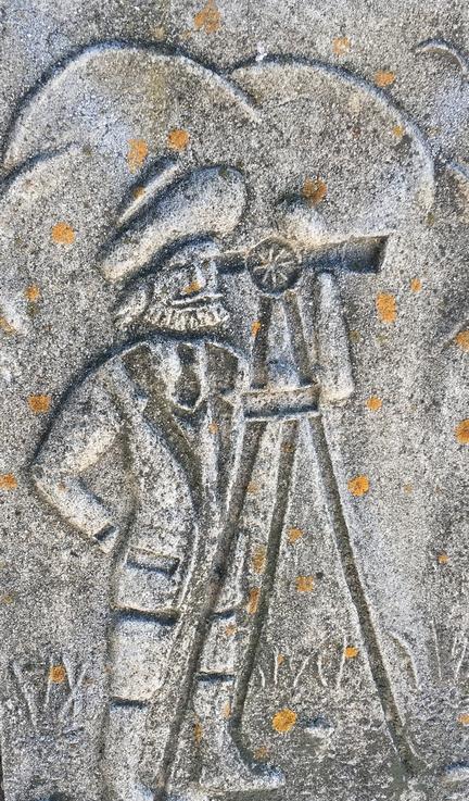 survey man stone carving