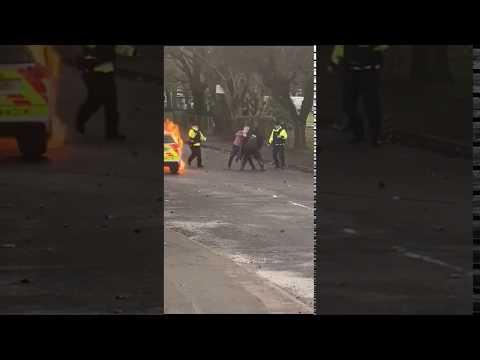 2 Hooded Men Set Police Car On Fire