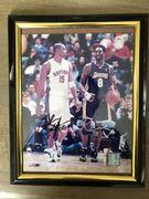 Likely Not Genuine: Kobe Bryant signed 8x10 photo framed $162.50