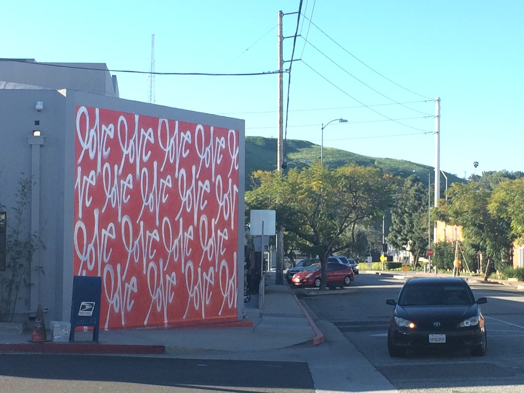 Artist curtis kulig has given his iconic love wall on hayden ave in the culver city a well deserved make over