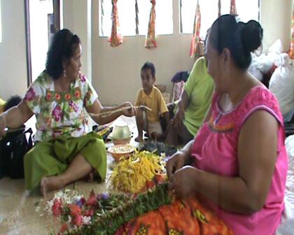 Nei Tute making traditional flower garlands Methodist Church maneaba Nuku