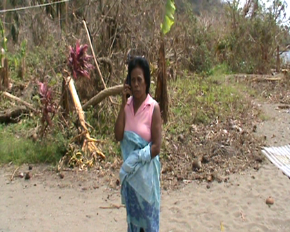 Nei Tabera from Eritabeta talking on staelitte phone to family in Suva