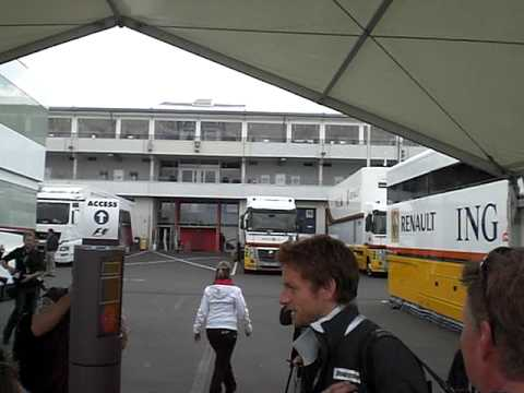 Jenson Button signing autographs at the German F1 Grand Prix at Nuerburgring