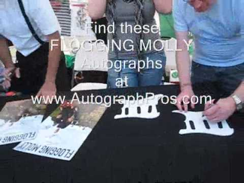Flogging Molly Signing Autographs for fans at Vans Warped Tour Hartford, CT 2009