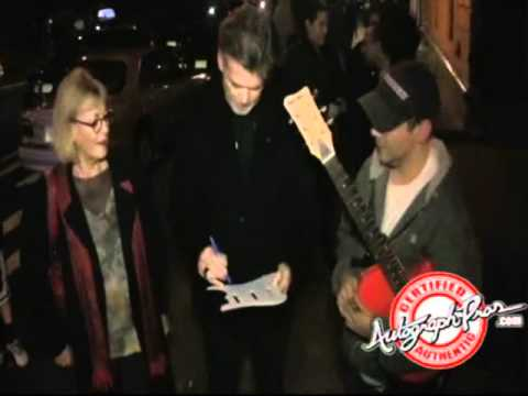 Pierce Brosnan Signing Autographs in New York City for Charity
