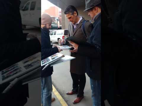 Stu Grimson of the Nashville Predators signs autographs for fans in Edmonton