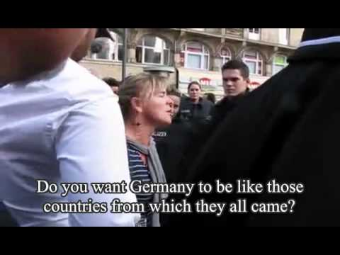 Female Protester Disrupts Muslim Radicals Rallying in Frankfurt, Germany