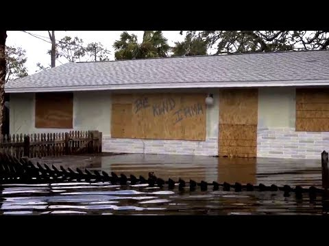 Bonita Springs residents wade home waist-deep in water following Irma