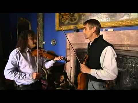 Learning to play the fiddle.  Jeremy Irons shows how. Faoi Lán Cheoil -- 06 - TG4