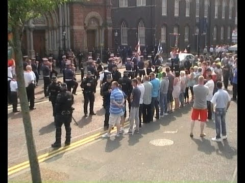 Orange Bands Play 'The Sash' passing St  Patrick's Church in Belfast
