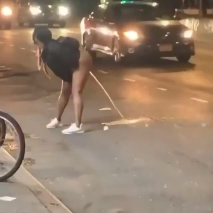 Lady pees in the street