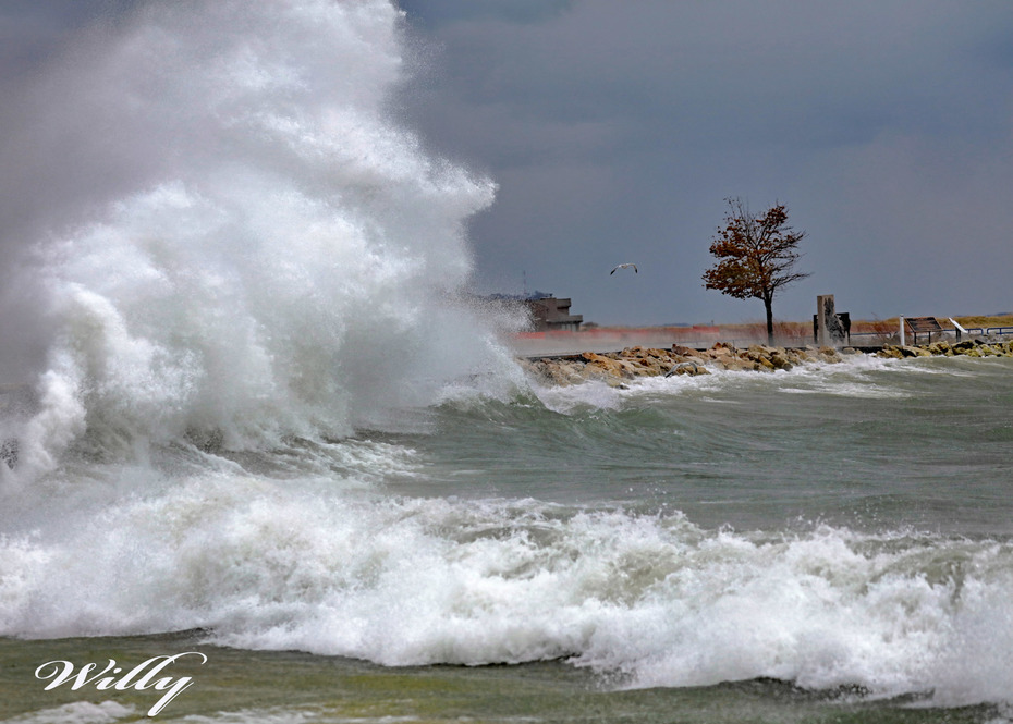 Waves hitting seawall inside Ludington Michigan's  Harbor