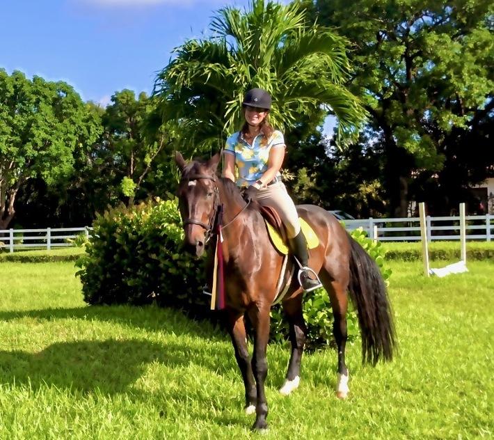 Bricole Reincke on her horse in the field