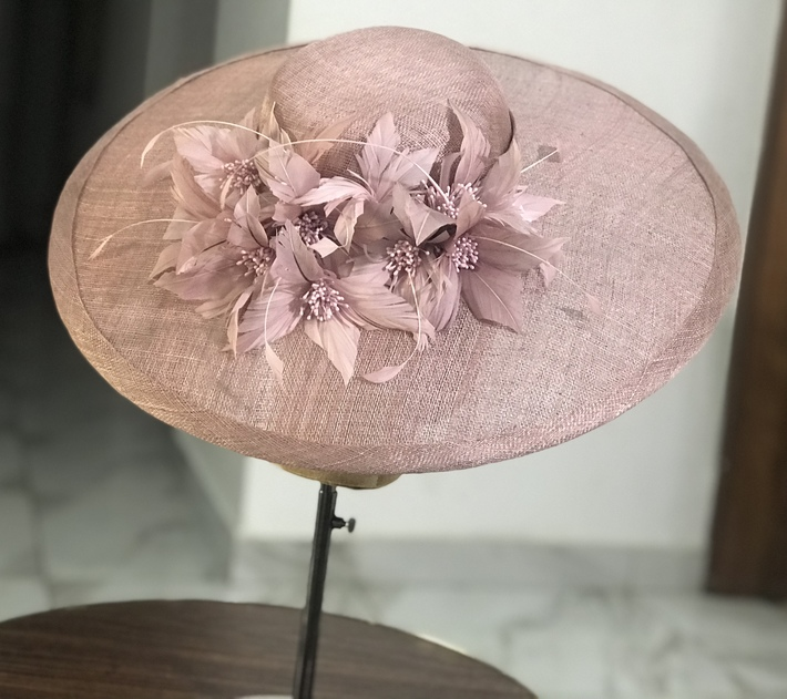 Dusty pink hat in her element