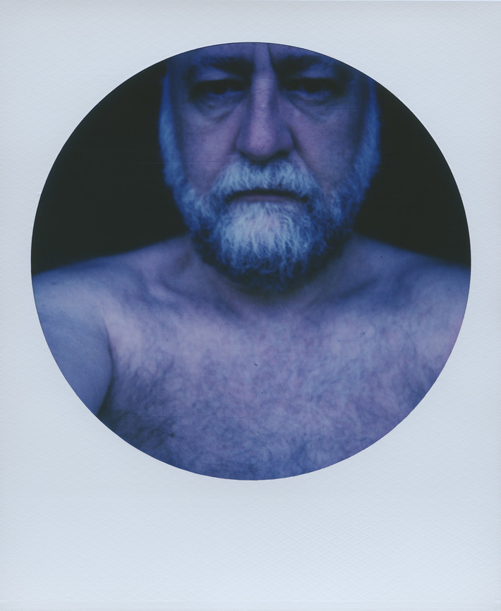 Backpain — selfie with blue filter and painkillers