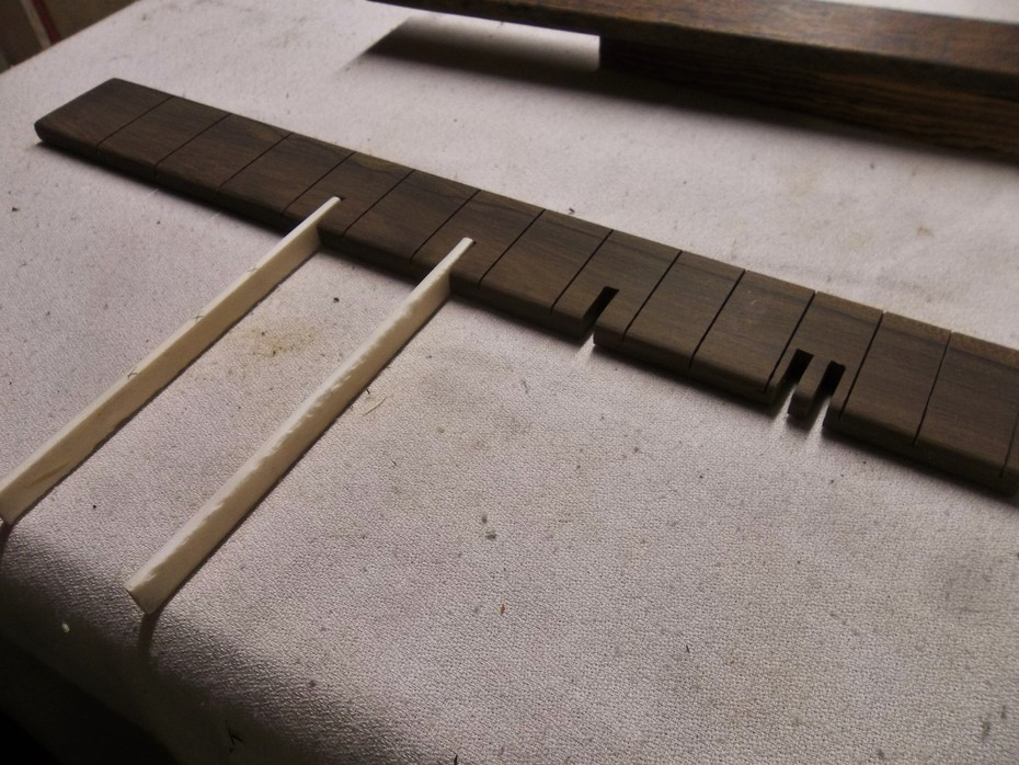 Working on a Ziricote fretless fretboard