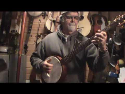 Tambourine insert tunneled 5th string banjo